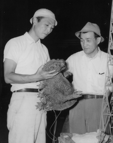 Ishiro Honda (l) and Effects Master Eiji Tsuburaya (r) inspect a mechanized Godzilla puppet during the production of GODZILLA RAIDS AGAIN (1955)