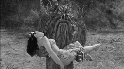 Kimo's traitorous wife Korey (Suzanne Ridgeworth) is carried off by the tree that was once her husband.